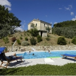 """An investment opportunity to buy an agriturismo as a going concern just 1kms from the Village and 28 km from the Adriatic Coast This working agriturismo, sleeping 20, is located in in the hills of the province of Ascoli Piceno and covers a total of 6 hectares, which includes an olive grove of 400 olive threes giving about 600 liters of extra virgin olive oil including """"Carboncella"""" a rare quality of local olives, planted woodland and several fruit trees. There is a big separate concrete storage of 100 sqm and a swimming pool of 12×6 with solarium. The main building ( yellow house of 200 sqm) contains 2 apartments sleeping a total of 15 people (4 bedrooms plus sofabeds) all with kitchen and sitting area. Each apartment has an independent entrance and heating system. The second building (stone house of 190 sqm) has 2 B&B rooms with a total sleeping 8 (with sofabeds), each with private bathroom, and direct access to a huge terrace with outside dining area, the internal area is easily convertible into a two double bedroom apartment. The bottom floor has a restaurant with fully equipped kitchen, storage and two bathrooms, ( which could very easily be converted into two double-bedroomed apartments or a three bedrooms apartment). .Net surface : 200+190+100 sqm 2 apartments 2 B&b rooms 6 bathrooms Plenty of space for Campsite places panoramic terrace and Pizza oven. The finishings are in excellent condition. All services are present and in perfect working order. The property is correctly registered as Agriturismo. The property has been correctly restored following planning permission . Solar Panels for hot water Photovoltaic panels (3kw). The vendor is ready to sell the two properties separately as follows.: Yellow house with 3 hectares of land 280.000 euro Stone house with 3 hectares of land 330.000 euro Both properties with 6 hectares of land 590.000 euro. The vendor is ready to sell additional land subject to negotiation (extra 10 hectares of land)"""