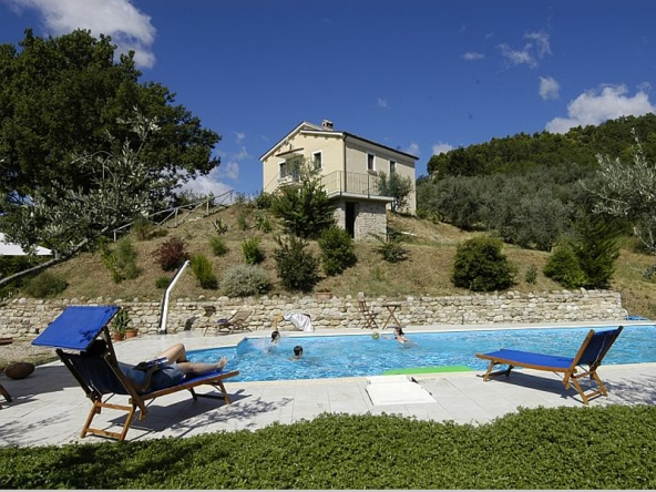 "An investment opportunity to buy an agriturismo as a going concern just 1kms from the Village and 28 km from the Adriatic Coast This working agriturismo, sleeping 20, is located in in the hills of the province of Ascoli Piceno and covers a total of 6 hectares, which includes an olive grove of 400 olive threes giving about 600 liters of extra virgin olive oil including ""Carboncella"" a rare quality of local olives, planted woodland and several fruit trees. There is a big separate concrete storage of 100 sqm and a swimming pool of 12×6 with solarium. The main building ( yellow house of 200 sqm) contains 2 apartments sleeping a total of 15 people (4 bedrooms plus sofabeds) all with kitchen and sitting area. Each apartment has an independent entrance and heating system. The second building (stone house of 190 sqm) has 2 B&B rooms with a total sleeping 8 (with sofabeds), each with private bathroom, and direct access to a huge terrace with outside dining area, the internal area is easily convertible into a two double bedroom apartment. The bottom floor has a restaurant with fully equipped kitchen, storage and two bathrooms, ( which could very easily be converted into two double-bedroomed apartments or a three bedrooms apartment). .Net surface : 200+190+100 sqm 2 apartments 2 B&b rooms 6 bathrooms Plenty of space for Campsite places panoramic terrace and Pizza oven. The finishings are in excellent condition. All services are present and in perfect working order. The property is correctly registered as Agriturismo. The property has been correctly restored following planning permission . Solar Panels for hot water Photovoltaic panels (3kw). The vendor is ready to sell the two properties separately as follows.: Yellow house with 3 hectares of land 280.000 euro Stone house with 3 hectares of land 330.000 euro Both properties with 6 hectares of land 590.000 euro. The vendor is ready to sell additional land subject to negotiation (extra 10 hectares of land)"